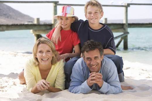 Stock Photo: 4029R-263456 A family laying on a beach