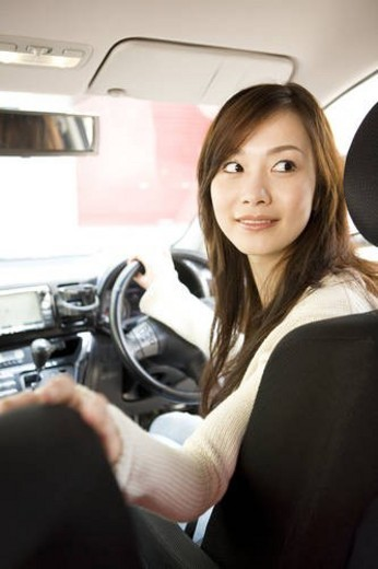 Young woman driving car : Stock Photo