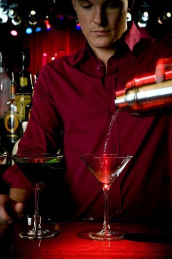 Stock Photo: 4029R-267527 A barman mixing cocktails