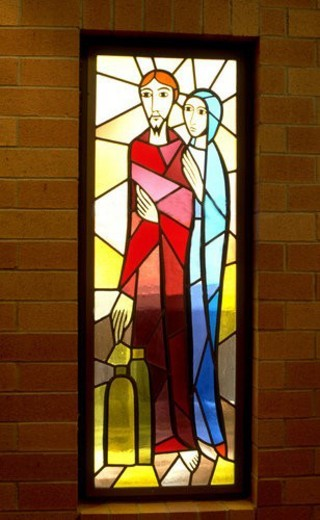 Mother Mary and Joseph on stained glass window : Stock Photo