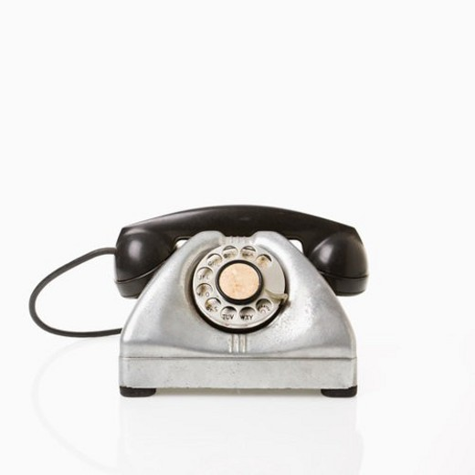 Rotary telephone with black receiver. : Stock Photo