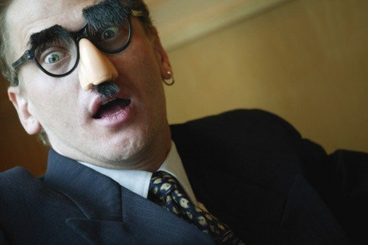 Stock Photo: 4029R-269036 Businessman looking surprised wearing Groucho Marx disguise