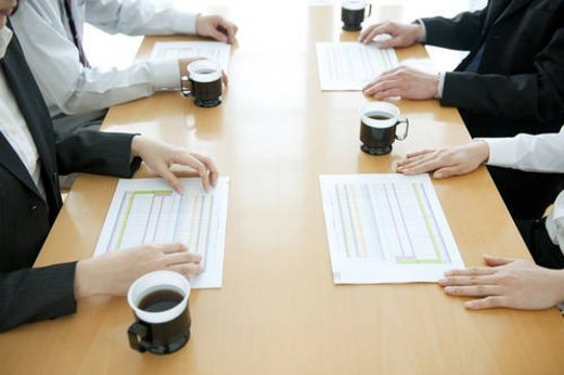 Stock Photo: 4029R-269783 Colleagues working at desk in office