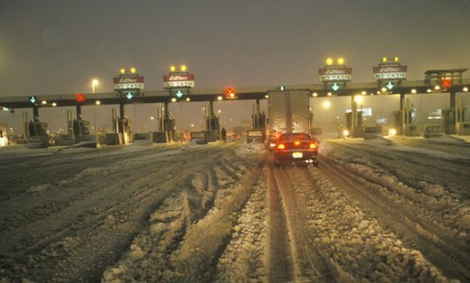 Toll gate in New Jersey after winter snowstorm and much snow at night : Stock Photo