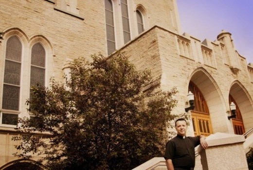 A priest standing outside the church : Stock Photo