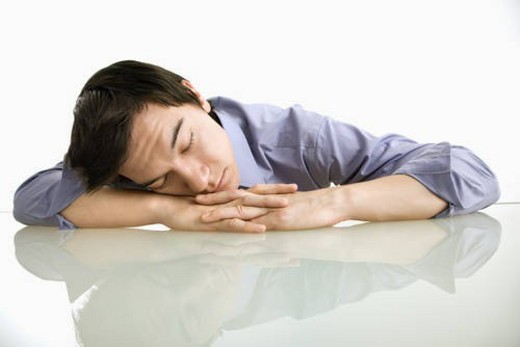 Stock Photo: 4029R-272246 Asian businessman sleeping on desk in the office.