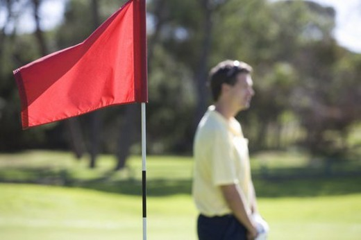 Flag on a golf course, close-up : Stock Photo