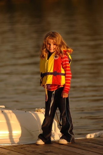 Young girl in life jacket : Stock Photo