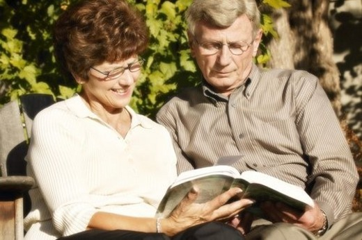 Couple read together : Stock Photo