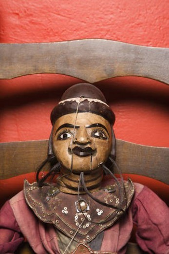 Stock Photo: 4029R-277130 Close up of wooden puppet sitting on chair.