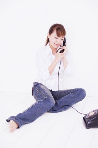 The Woman Who Telephones : Stock Photo