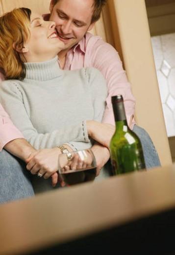 Couple celebrates with wine : Stock Photo