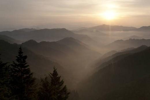 Mountain range surrounded by fog : Stock Photo