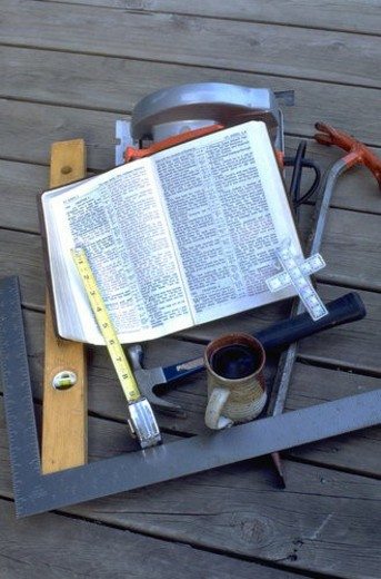 Stock Photo: 4029R-28145 Carpenters tools Bible cross mug level tape measurer hammer and saw . St Paul Minnesota USA