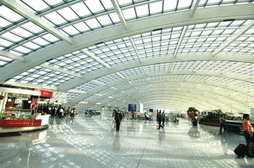 Passengers in an airport, Beijing Capital International Airport, Beijing, China : Stock Photo