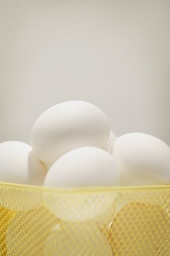 Stock Photo: 4029R-282703 Basket of eggs