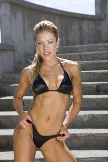 fit model posing in a bikini on a concrete staricase : Stock Photo