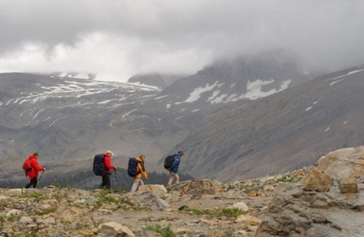 Hikers on a mountain top, Rocky Mountains, Canada : Stock Photo