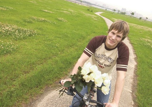 Stock Photo: 4029R-283408 Portrait of a young man riding a cycle
