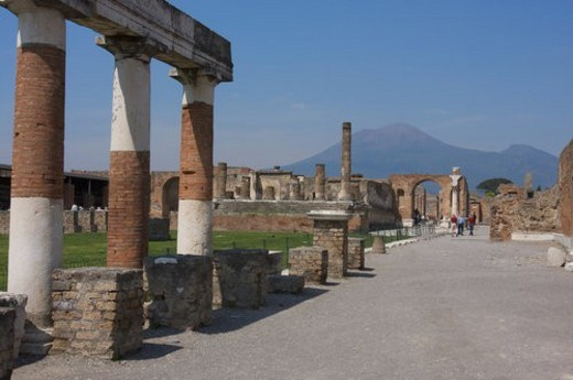Stock Photo: 4029R-283484 In the shadow of Vesuvius, the ruins of Pompei - Forum, with Vesuvius seen through Arch