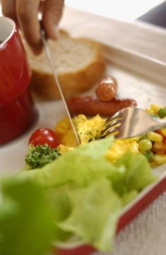 Stock Photo: 4029R-28395 Woman Eating Breakfast