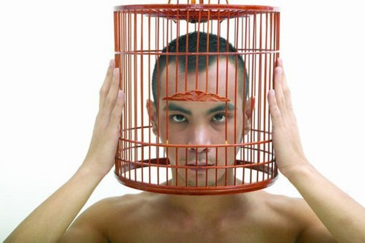 Stock Photo: 4029R-284025 Bare Chest, Cage, Birdcage, Asian Ethnicity
