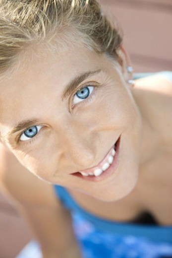 Close-up of Caucasian mid-adult woman smiling and looking at viewer. : Stock Photo
