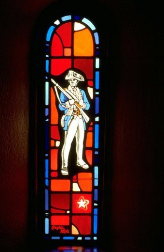Soldier from the revolutionary war on stained glass : Stock Photo