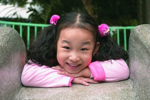 Stock Photo: 4029R-286521 Toothy Smile, Asian, Leaning, One Child Only, Innocence, Pigtails
