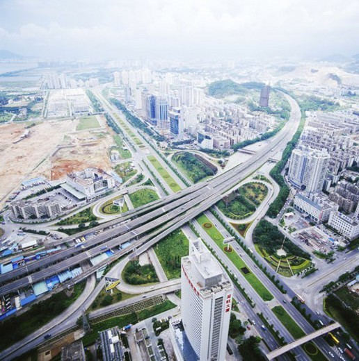 Stock Photo: 4029R-28764 High angle shot of cloverleaf junction and skyscrapers,Shenzhen
