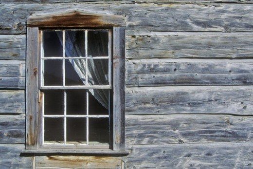 Stock Photo: 4029R-289713 Window with curtain in log building in Ghost Town