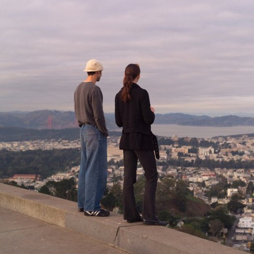 Man and Woman taking in Aerial View of San Francisco : Stock Photo