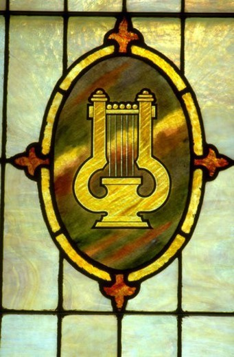 Stock Photo: 4029R-291069 Lyre or harp on stained glass window