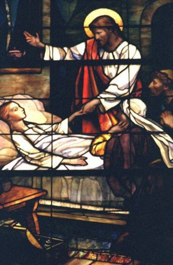 Jesus healing a sick child depicted on stained glass : Stock Photo