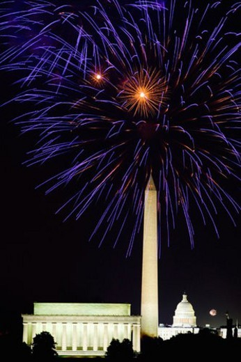 Fourth of July celebration with fireworks exploding over the Lincoln Memorial, Washington Monument and U.S. Capitol, Washington D.C. : Stock Photo