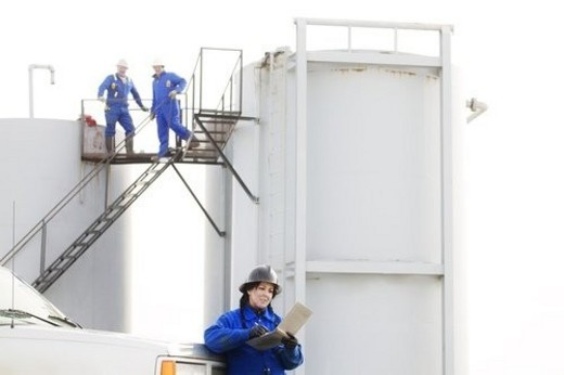 Stock Photo: 4029R-297844 Industrial workers at an oilfield