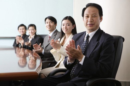 A portrait of office young men and young women applauding : Stock Photo