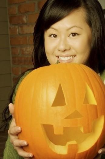 Girl holding a jack-o-lantern : Stock Photo
