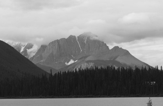 Panoramic view of mountain peaks enveloped with fog, Rocky Mountains, Canada : Stock Photo