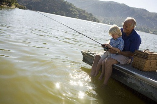 Grandfather and grandson fishing : Stock Photo