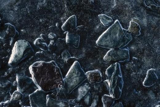 Ice on stones : Stock Photo
