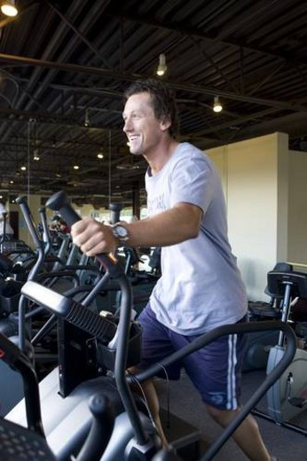 Stock Photo: 4029R-301774 Fit male exercising in a gym. Workout.