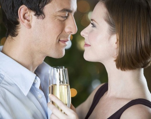 A couple drinking champagne : Stock Photo