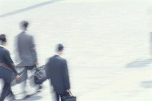 Businessmen walking : Stock Photo