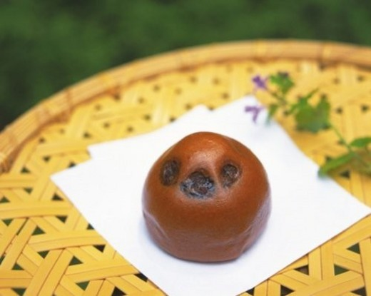 Wagashi called Cha manjyu on bamboo bowl, high angle view, Differential Focus : Stock Photo