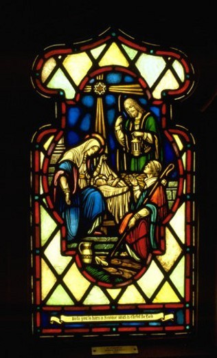 Stained glass window of Jesus in manger at Pilgrim Lutheran Church : Stock Photo