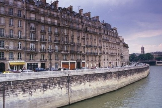 Image of Several Grey-colored Apartments Along the Seine By Sunset, Side View, Paris, France : Stock Photo