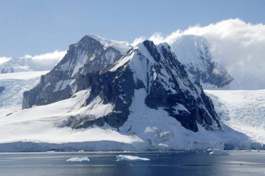 Iceberg in foreground.  Arctowski Peninsula, Antarctica : Stock Photo