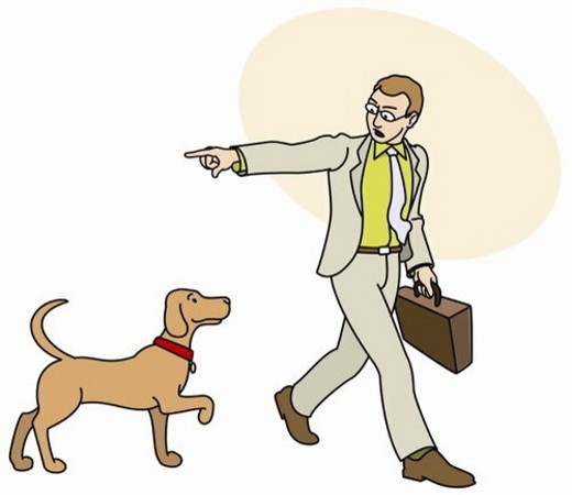 Man off to work telling his dog to go home : Stock Photo