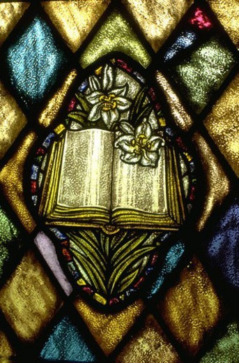 Bible and lilies on stained glass window : Stock Photo